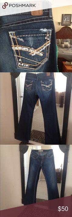 BKE Stella jeans 27 NWOT BKE Stella size 28 33 1/2 length awesome buy!!! Bling on pockets dark wash BKE Jeans Flare & Wide Leg