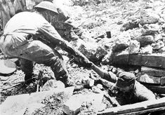 A soldier from the Polish II Corps helps a German sniper out of the ruins in Piedimonte San Germano, 1944.