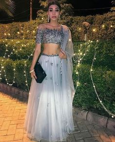 Luxe gray sequined lehenga perfect for an Indian wedding or formal occasion. A-line skirt with a sequined top including a built in bra. Indian Attire, Indian Ethnic Wear, Indian Style, Pakistani Dresses, Indian Dresses, Hindus, Traje A Rigor, Indian Lehenga, Indian Saris