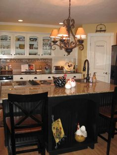 French Country Inspired Kitchen.  Great lighting - both recessed and ranch-style lighting fixture.