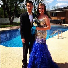 Kate Vonier sparkles in a Mac Duggal prom dress. Feather prom dress with sequined bodice.