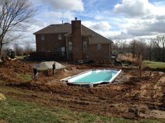 Pool is in.... On to retaining wall and concrete.