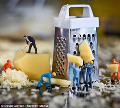 Tiny workmen grate hunks of cheese, in You're Doing A Grate Job Little men...