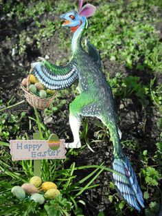 Easter greetings from our Carnegie Caudipteryx disguised with bunny ears and carrying a basket of colorful eggs. Photo taken by Ashli Lenox, an avid Facebook follower.
