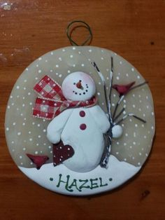 One of my personal favorites and top seller this year, a mixed media piece. This hand sculpted 3 translucent round polymer ornament features a snowman holding my hand cut paper heart and a branch with 2 hand made red birds. Varied plaid ribbon. Store this ornament anywhere as the