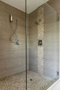 love the pebbles on the floor (free daily foot massage!) might switch the vertical column to glass tiles to look like water flowing down...