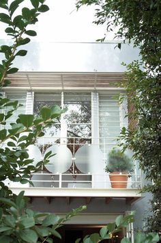 Traditional balcony design deck eclectic with-] plant pots louvered windows light gray.