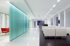 Teal Glass wall - Group Goetz in Washington, D.C.  by Foley & Lardner http://www.contractdesign.com/contract/design/features/New-LifeGroup-Goetz-5173.shtml#