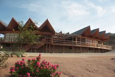 Arikok National Park visitor center. The building was designed with louvers to capture the wind. The wind passes over a water basin and is used to cool parts of the building, avoiding the need for airconditioning. South American hardwood is used to have as little maintenance as possible.