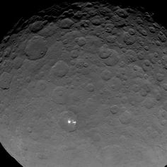 Scientists say the white spots on the dwarf planet Ceres are definitely reflecting sunlight. This wide view of the strange Ceres features was captured by NASA's Dawn spacecraft on May 16, 2015.<br />