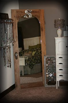 I don't like the color of this door or how it's made but I love the idea of making an old door into a full length mirror!