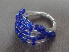 Cobalt Blue Glass Spiral Ring- silver. $25.00, via Etsy.