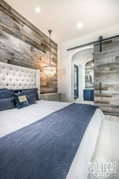 What a sophisticated space! Reclaimed Tobacco Barn Grey wood wall installed for a customer in the Master Bedroom of their home in Scottsdale, AZ.  The wall, sliding barn door, and arched bathroom back drop turned out great!  It looks perfect with the bed, night stands & chandeliers accesories.