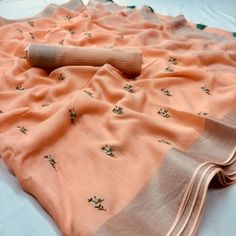 Add another string to your summer style and get artistic with this Peach color linen saree. Beautified with Embroidary work all over saree,Comes with matching unstitched linen blouse piece, this style calls for heels, metallic accessories and a clutch. Brocade Lehenga, Handloom Saree, Georgette Sarees, Lehenga Choli, Net Saree, Kurti, Peach Color Saree, Orange Saree, Soft Silk Sarees