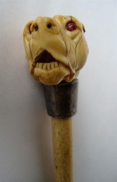 A carved ivory and bone dog headed cane, English, circa 19th… - Walking Sticks -