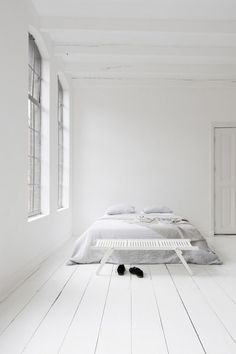 White flooring. Mnimalist Bedroom