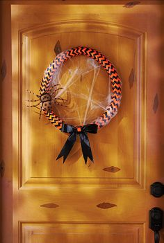 This cute orange and black Halloween wreath is made from duct tape and pipe insulation! Click through for the easy tutorial on The Home Depot Blog.