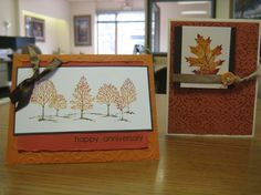 I love the simple trees and the torn paper.  The leaf is great too and I love the ribbon with a button.
