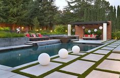 A perfect pool waterfall idea for those who love sleek minimalism by Creative Environments