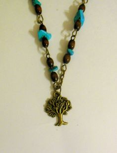 Bronze colour necklace with tree pendant and brown, turquoise colour beads.