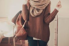 Love the sweater and bulky scarf.