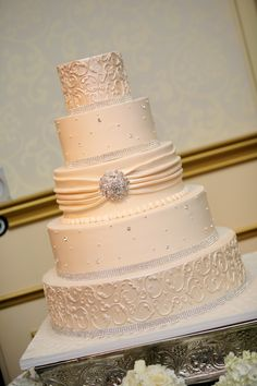 Ivory cake with bow at luxury wedding venue-The Grove in New Jersey.