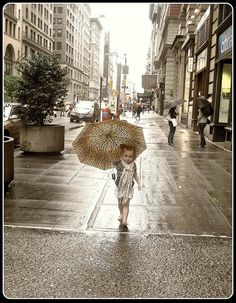 Little Lady with Umbrella strolling down 5th ave NY - june 2009