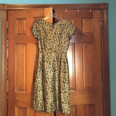 Vintage black and gold 1940s dress Vintage black and gold 1940s dress in great condition. No size listed, fits like a 4. I adore this dress but it is just too snug now, would love to pass it along to another vintage lover! Cohen bros style Dresses