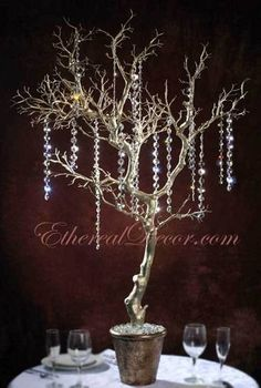 How to make iced branches winter wedding centerpieces winter diy tree branch and crystal centerpiece junglespirit Image collections