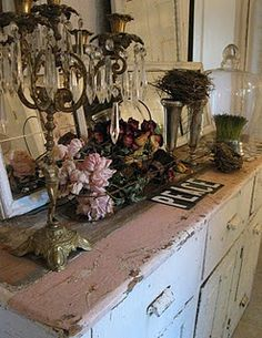 Faded roses,Victorian Crystal candle stick, rustic pink sideboard, cloche, windows, message? *sigh*