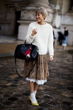 Everything about her is cute! Haircut, snake pattern, sweater, heels, little socks, petticoat!