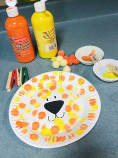 A fun fine-motor skills activity in making a lion mask. Kids use clothespins to dot with Pom poms.
