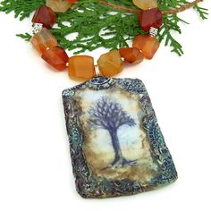"The Tree of Life pictured on the artisan polymer clay pendant reminds me of favorite characters from Tolkien's ""Lord of the Rings"" trilogy:  the Ents, protectors of the ancient forest.  Because of that I HAD to name the handmade necklace FOREST SENTINEL."