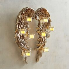 Angel wings tea light holder candle wall sconce, to add a touch of magic to my Christmas decor. This would look beautiful hanging nearby our tree!  Aff