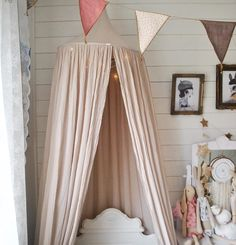 Numero74 canopy in powder and mix pink bunting garland