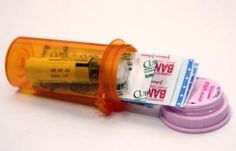 DIY mini first-aid kit using a prescription bottle.