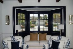 Here are some custom wood window shutters painted black.