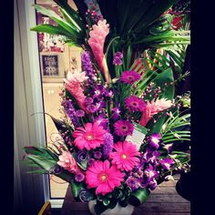 #GORGEOUS ! #Tropical #arrangement from our Southgate store! Pink ginger and gerberas paired with purple liatris, mini gerberas, daisies and orchids. Not to mention the fun purple spirals!