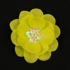 Yellow Sequin Hair Flower:These darling flower have just enough bling. They are a layered stemless flower head with a hand sewn sequin center.4.5 inches longest point end of leaf to end of leaf. They are mounted to a flat single prong hair clip. This one is chrtruese-y yellow. Hand made in the USA. $6.00