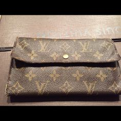 Authentic Louis Vuitton Wallet Authentic Louis Vuitton Wallet. This was my first wallet from LV. Ladies this wallet has some years and usage on it. It can be repaired took to LV store but I didn't want to wait 4 to 6 weeks to come back after repair. I have 4 additional wallet I don't use this one. Only reason for low prices. I had been loved and used. Still a good LV wallet. Louis Vuitton Bags Wallets