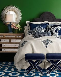 Wow!  Never would have thought of green wall color and navy/white bedding.