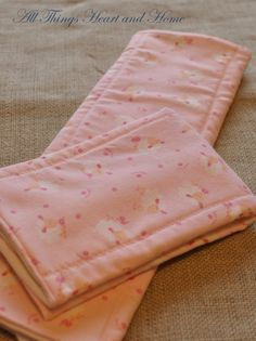 DIY burp cloths- I have tons of the cotton prefolds and, rather than buying new fabric, I'll use the 8 million receiving blankets I already own! Easy baby shower gift! :)