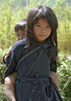 hmong sister with her brother, vietnam.