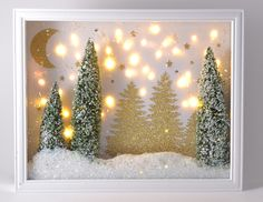 Winter Twinkle Display Tutorial + Silhouette Giveaway This winter twinkle light display is so pretty! Make your own with bottle brushes, buffalo snow and a shadow box. Diy Tableau, Christmas Holidays, Christmas Decorations, Christmas Train, Christmas Shadow Boxes, Christmas Box Frames, Diy Shadow Box, Holiday Crafts, Holiday Decor