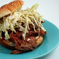 Slow Cooked Barbecued Pulled Pork Sandwiches with North Carolina Style Vinegar Sauce and Coleslaw