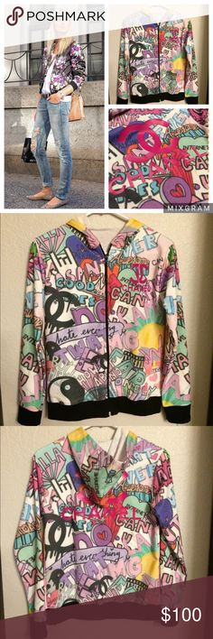 """Graffiti Graphic Track Jacket Get the """"shopping is my cardio"""" look! Features a chic all over print, logo imprint on front and back, hoodie, solid color cuffs and hem to complete the look. Poly/Cotton Blend. One Size Fits: S/M zipped up or larger if worn unzipped! This is a no brand fashion sweater. Please be mindful of this detail before purchasing. NWOT *Open to Reasonable Offers* CHANEL Jackets & Coats"""