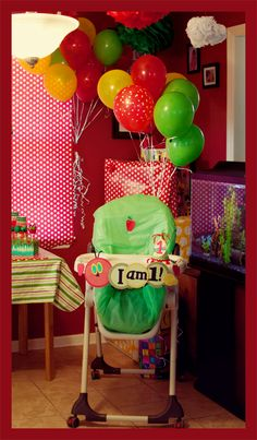 Hungry Caterpillar Party - love the balloons and the sign for the high chair!