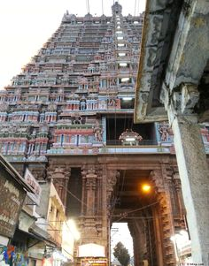 The 236 feet tall gopuram (temple tower) of the Sri Ranganathaswamy Temple at Srirangam in Tamilnadu, India is one of the tallest in the world. One of the gopurams here is fully made of gold, and is protected by an electrical fence.    The Temple complex spread over an area of 156 acres is the biggest functioning temple in the world. The temple at AngkorWat is bigger, but currently is a non-functioning one. In ancient times city of Srirangam lived completely inside the walls of this temple.