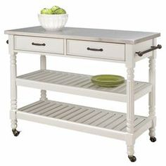 """Display a fresh floral bouquet or stow kitchen essentials with this lovely cart, showcasing 2 drawers, 2 slatted shelves and a stainless steel top.     Product: Kitchen cartConstruction Material: Wood and stainless steelColor: White and silverFeatures:  Two open shelvesRolling casters with locking mechanismTwo drawersTowel rack Dimensions: 36"""" H x 47.25"""" W x 20.5"""" DAssembly: Assembly requiredCleaning and Care: Clean with a damp cloth"""