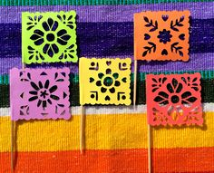 Spice up your snack table with these cute mini papel picado inspired flags!